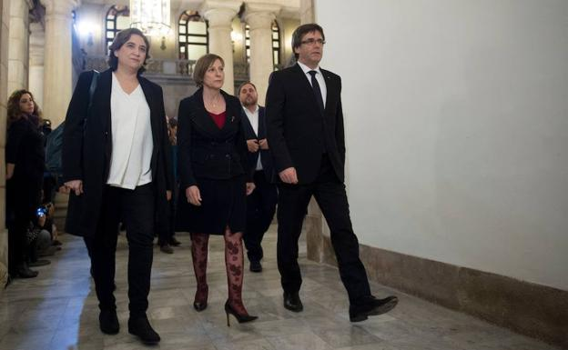 Ada Colau, Carme Forcadell y Carles Puigdemont./Josep Lago (Afp)